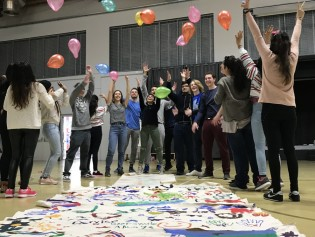 CAS students hosting a birthday party for Refugee children